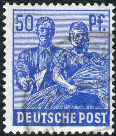 obliteration: GERMANY - CIRCA 1948: Postage stamp printed in Germany, shows Reaping Wheat, circa 1948