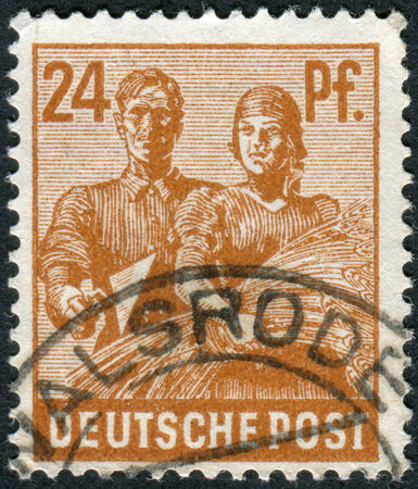 obliteration: GERMANY - CIRCA 1947: Postage stamp printed in Germany, shows Reaping Wheat, circa 1947 Editorial