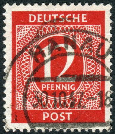 obliteration: GERMANY - CIRCA 1946: Postage stamp printed in Germany, shows the face value stamps, circa 1946