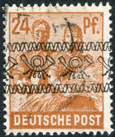 obliteration: GERMANY - CIRCA 1947: Postage stamp printed in Germany (overpint Type A: US and British occupation zone), shows the Reaping Wheat, circa 1947