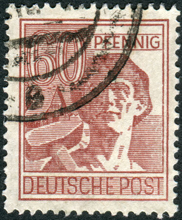 obliteration: GERMANY - CIRCA 1948: Postage stamp printed in Germany, shows the laborer, circa 1948