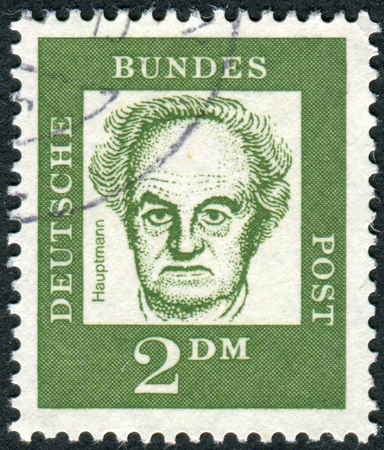obliteration: GERMANY - CIRCA 1962: Postage stamp printed in Germany, shows portrait of Gerhart Hauptmann, circa 1962