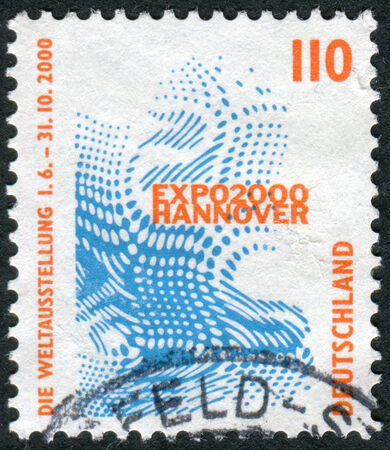 obliteration: GERMANY - CIRCA 1998: Postage stamp printed in Germany, shows Emblem of the World Exhibition EXPO 2000, Hannover, circa 1998