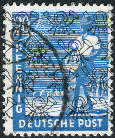 postwar: GERMANY - CIRCA 1947: Postage stamp printed in Germany (overpint Type B: US and British occupation zone), shows the sower, circa 1947 Editorial