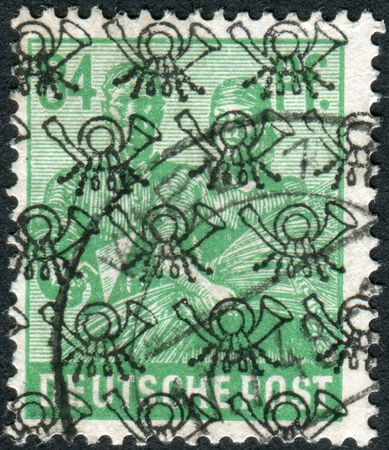 reaping: GERMANY - CIRCA 1947: Postage stamp printed in Germany (overpint Type B: US and British occupation zone), shows the Reaping Wheat, circa 1947