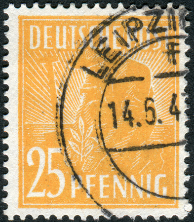 obliteration: GERMANY - CIRCA 1947: Postage stamp printed in Germany, shows Planting Olive, circa 1947 Editorial