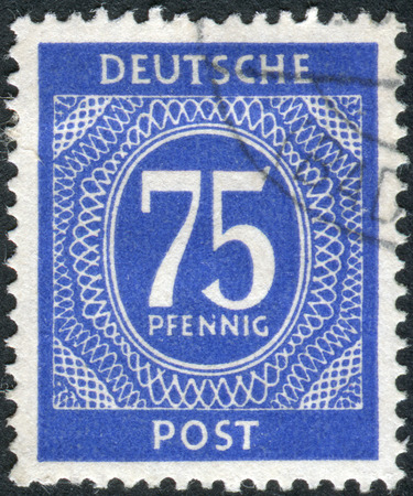 postwar: GERMANY - CIRCA 1946: Postage stamp printed in Germany, shows the face value stamps, circa 1946