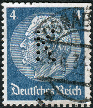 GERMANY - CIRCA 1934: Postage stamp printed in Germany (German Reich) with perfin K, shows the 2nd President of Germany, Paul von Hindenburg, circa 1934 Editorial