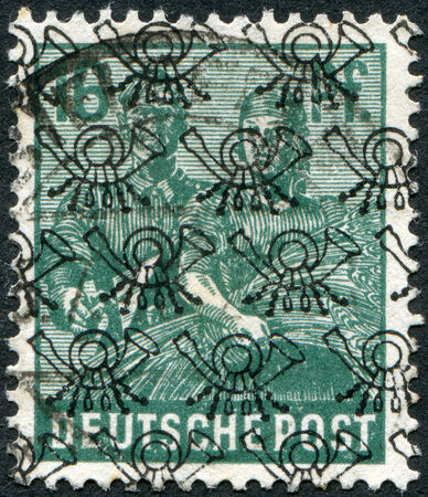 obliteration: GERMANY - CIRCA 1947: Postage stamp printed in Germany (overpint Type B: US and British occupation zone), shows the Reaping Wheat, circa 1947
