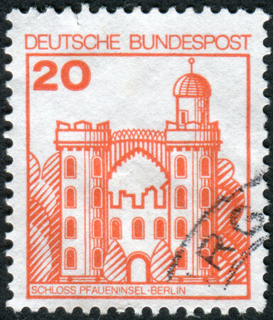 obliteration: GERMANY - CIRCA 1979: Postage stamp printed in Germany, shows Peacock Island Castle (Pfaueninsel), Berlin, circa 1979