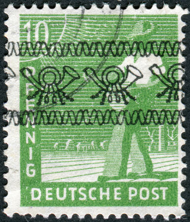 obliteration: GERMANY - CIRCA 1947: Postage stamp printed in Germany (overpint Type A: US and British occupation zone), shows the sower, circa 1947 Editorial