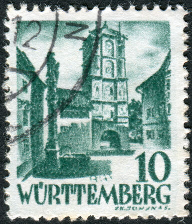 obliteration: GERMANY - CIRCA 1948: Postage stamp printed in Germany (Wurttemberg-Hohenzollern, French occupation zone), shows Town Gate of Wangen (Allgau), circa 1948 Editorial
