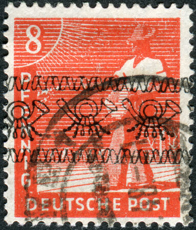 postwar: GERMANY - CIRCA 1947: Postage stamp printed in Germany (overpint Type A: US and British occupation zone), shows the sower, circa 1947 Editorial