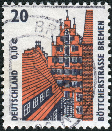 obliteration: GERMANY - CIRCA 2001: Postage stamp printed in Germany, shows Boettcherstreet, Bremen, circa 2001 Editorial