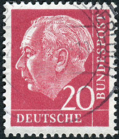 obliteration: GERMANY - CIRCA 1954: Postage stamp printed in Germany, shows the 1st President of the Federal Republic of Germany, Theodor Heuss, circa 1954