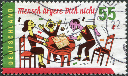 mensch: GERMANY - CIRCA 2010: A stamp printed in Germany, shows the board game Mensch aergere dich nicht, circa 2010