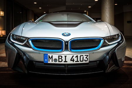 sports car: BERLIN - NOVEMBER 28, 2014: Showroom. The BMW i8, first introduced as the BMW Concept Vision Efficient Dynamics, is a plug-in hybrid sports car developed by BMW Editorial
