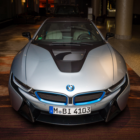 developed: BERLIN - NOVEMBER 28, 2014: Showroom. The BMW i8, first introduced as the BMW Concept Vision Efficient Dynamics, is a plug-in hybrid sports car developed by BMW Editorial