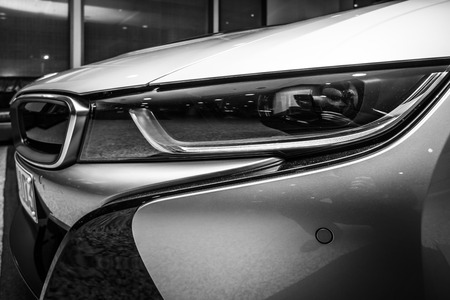 developed: BERLIN - NOVEMBER 28, 2014: Showroom. A fragment of the car BMW i8, first introduced as the BMW Concept Vision Efficient Dynamics, is a plug-in hybrid sports car developed by BMW. Black and white.