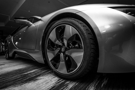 developed: BERLIN - NOVEMBER 28, 2014: Showroom. The BMW i8, first introduced as the BMW Concept Vision Efficient Dynamics, is a plug-in hybrid sports car developed by BMW. Black and white.