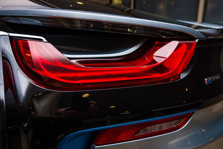 developed: BERLIN - NOVEMBER 28, 2014: Showroom. The rear lights of the car BMW i8, first introduced as the BMW Concept Vision Efficient Dynamics, is a plug-in hybrid sports car developed by BMW.