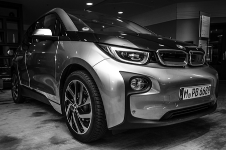 i3: BERLIN - NOVEMBER 28, 2014: Showroom. The BMW i3, previously Mega City Vehicle (MCV), is a five-door urban electric car developed by the German manufacturer BMW. Black and white.
