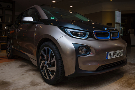 i3: BERLIN - NOVEMBER 28, 2014: Showroom. The BMW i3, previously Mega City Vehicle (MCV), is a five-door urban electric car developed by the German manufacturer BMW.