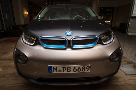 manufacturer: BERLIN - NOVEMBER 28, 2014: Showroom. The BMW i3, previously Mega City Vehicle (MCV), is a five-door urban electric car developed by the German manufacturer BMW.