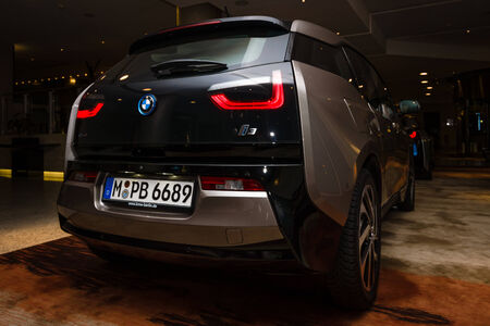 developed: BERLIN - NOVEMBER 28, 2014: Showroom. The BMW i3, previously Mega City Vehicle (MCV), is a five-door urban electric car developed by the German manufacturer BMW. Rear view.