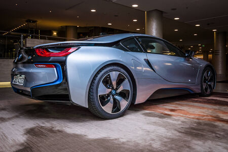 developed: BERLIN - NOVEMBER 28, 2014: Showroom. The BMW i8, first introduced as the BMW Concept Vision Efficient Dynamics, is a plug-in hybrid sports car developed by BMW. Rear view.