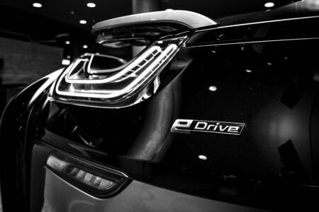 developed: BERLIN - NOVEMBER 28, 2014: Showroom. The rear lights of the car BMW i8, first introduced as the BMW Concept Vision Efficient Dynamics, is a plug-in hybrid sports car developed by BMW. Black and white