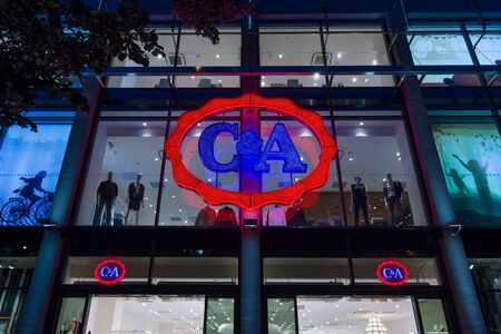 ca: PRAGUE, CZECH REPUBLIC - SEPTEMBER 04, 2014: C&A store in the evening lights. C&A is an international Dutch chain of fashion retail clothing stores (over 34,000 employees)