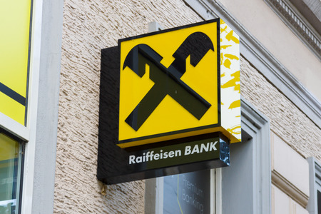 co operative: PRAGUE, CZECH REPUBLIC - SEPTEMBER 04, 2014: The branch of Raiffeisen Bank. Raiffeisen Bank - the largest co-operative banks in Europe, has more than 3,000 branches and 58,000 employees.