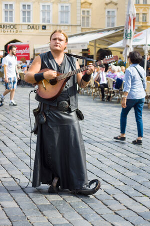 bagpipes: PRAGUE, CZECH REPUBLIC - SEPTEMBER 18, 2014: Performance of street musicians in medieval clothes on the Old Town Square.