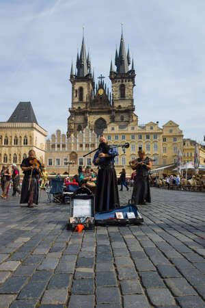 bagpipes: PRAGUE, CZECH REPUBLIC - SEPTEMBER 18, 2014: Performance of street musicians in medieval clothes on the Old Town Square. In the background Church of Mother of God in front of Tyn. Editorial
