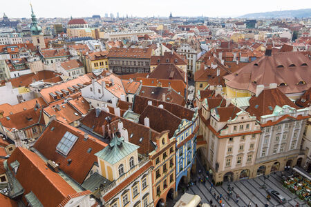 PRAGUE, CZECH REPUBLIC - SEPTEMBER 18, 2014: The roofs of old Prague. View from the tower of City Hall. Prague is the capital and largest city of the Czech Republic.