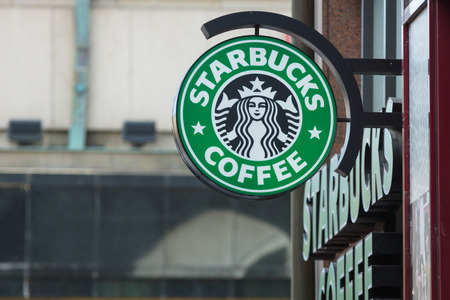 PRAGUE, CZECH REPUBLIC - SEPTEMBER 18, 2014: Starbucks Coffee. Starbucks is the largest coffeehouse company in the world, with 20,891 stores in 62 countries. Editoriali