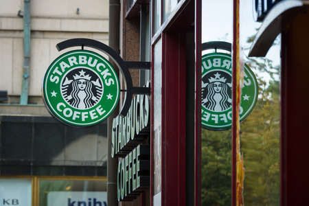 18 20: PRAGUE, CZECH REPUBLIC - SEPTEMBER 18, 2014: Starbucks Coffee. Starbucks is the largest coffeehouse company in the world, with 20,891 stores in 62 countries. Editorial