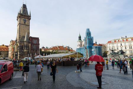 old town square: PRAGUE, CZECH REPUBLIC - SEPTEMBER 18, 2014: Tourists on Old Town Square. Old Town Square is a historic square in the Old Town quarter of Prague.