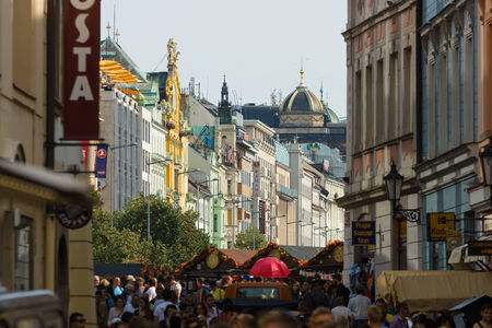 largest: PRAGUE, CZECH REPUBLIC - SEPTEMBER 18, 2014: Visitors and residents of the capital on the streets of the old town. In the background Wenceslas Square. Prague is the capital and largest city of the Czech Republic.