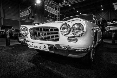 superleggera: MAASTRICHT, NETHERLANDS - JANUARY 08, 2015: Luxury car Lancia Flaminia GTL by Carrozzeria Touring. Black and white. International Exhibition InterClassics & Topmobiel 2015
