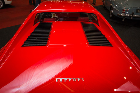 engine compartment: MAASTRICHT, NETHERLANDS - JANUARY 08, 2015: The engine compartment of a sports car Ferrari 308 GTB. Rear view. International Exhibition InterClassics & Topmobiel 2015 Editorial