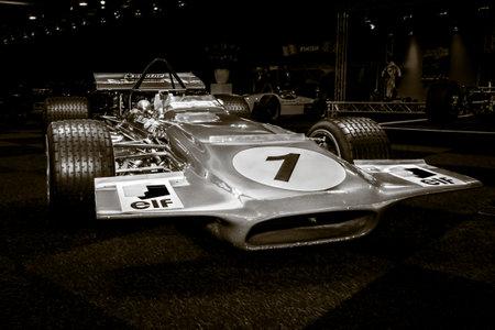 formula one car: MAASTRICHT, NETHERLANDS - JANUARY 08, 2015: Formula One car March 701, designed by Robin Herd, 1970. Stylization. Toning. International Exhibition InterClassics & Topmobiel 2015