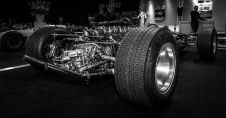 formula one car: MAASTRICHT, NETHERLANDS - JANUARY 08, 2015: Engine of a Formula One car Lotus 49, designed by Colin Chapman and Maurice Philippe, 1967. Black and white. International Exhibition InterClassics & Topmobiel 2015
