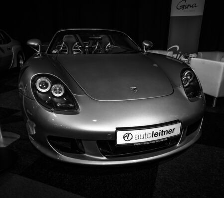 carrera: MAASTRICHT, NETHERLANDS - JANUARY 08, 2015: Supercar Porsche Carrera GT (Project Code 980), 2005. Black and white. International Exhibition InterClassics & Topmobiel 2015 Editorial