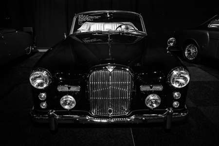 litre: MAASTRICHT, NETHERLANDS - JANUARY 08, 2015: British sports car Alvis Three Litre TD21 DHC - Series I, 1961. Black and white. International Exhibition InterClassics & Topmobiel 2015 Editorial