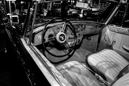 litre: MAASTRICHT, NETHERLANDS - JANUARY 08, 2015: Cabin of a British sports car Alvis Three Litre TD21 DHC - Series I, 1961. Black and white. International Exhibition InterClassics & Topmobiel 2015