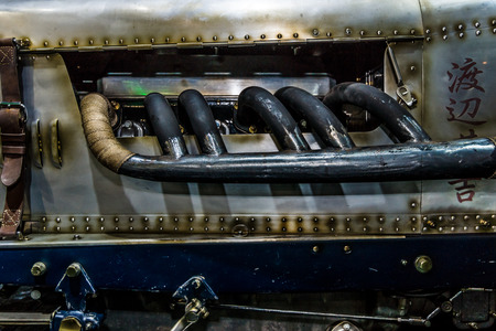 exhaust pipe: MAASTRICHT, NETHERLANDS - JANUARY 08, 2015: The exhaust pipe of a British sports car Invicta S-Type, 1931. International Exhibition InterClassics & Topmobiel 2015 Editorial