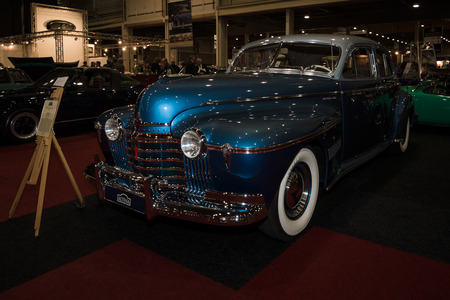 luxe: MAASTRICHT, NETHERLANDS - JANUARY 08, 2015: Full-size car Oldsmobile 98 De Luxe, 1941. International Exhibition InterClassics & Topmobiel 2015