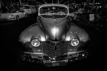 luxe: MAASTRICHT, NETHERLANDS - JANUARY 08, 2015: Full-size car Oldsmobile 98 De Luxe, 1941. Black and white. International Exhibition InterClassics & Topmobiel 2015
